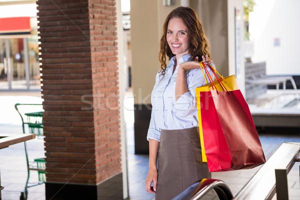Mooie vrouw roltrap winkelen portret vrouwelijke Stockfoto © wavebreak_media