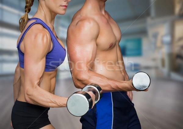 Hombre mujer levantamiento de pesas gimnasio compuesto digital Foto stock © wavebreak_media