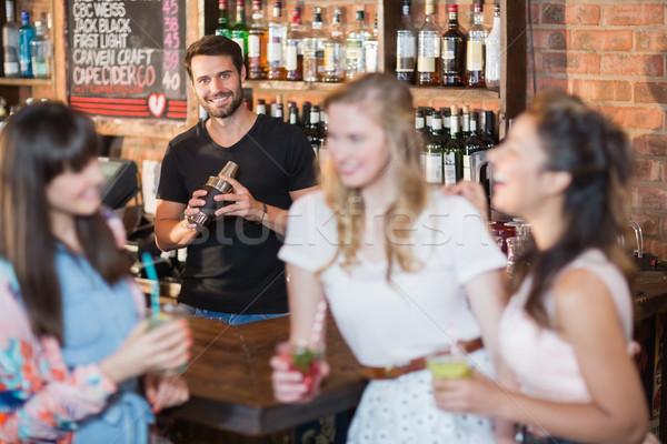 Portrait of bartender making drink Stock photo © wavebreak_media