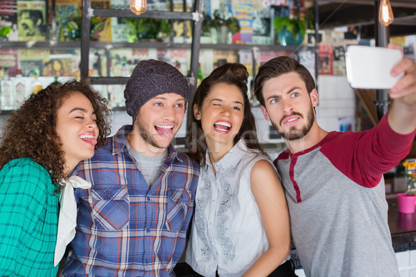 Friends making faces while talking selfie in restaurant Stock photo © wavebreak_media