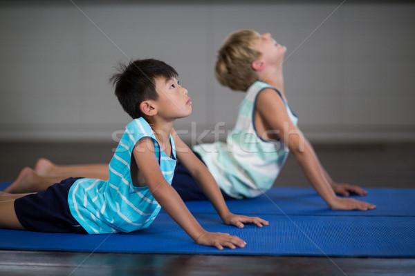 Siblings doing stretching exercise  Stock photo © wavebreak_media