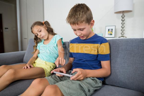 Sorridere fratelli digitale tablet divano soggiorno Foto d'archivio © wavebreak_media