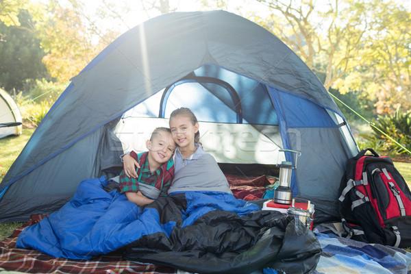 Testvérek ül sátor portré lány boldog Stock fotó © wavebreak_media