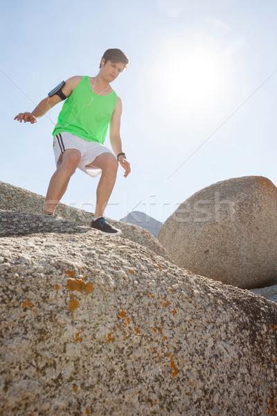 Férfi kész ugrás kő napos idő fitnessz Stock fotó © wavebreak_media