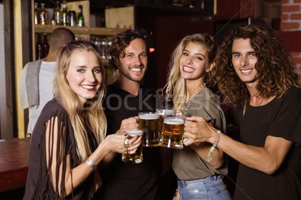 Portrait of friends toasting beer glasses Stock photo © wavebreak_media