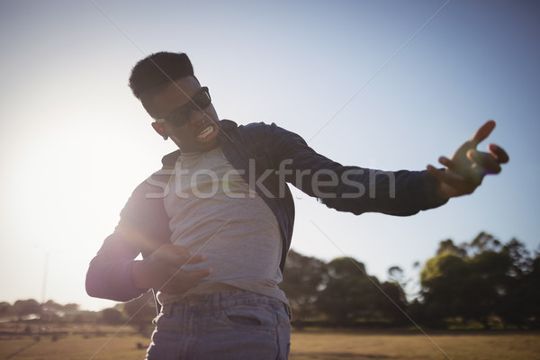 Close up of man gesturing while standing on field Stock photo © wavebreak_media