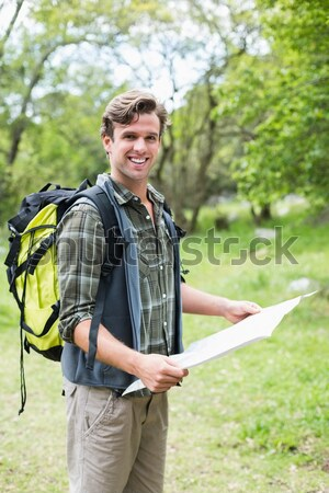 Trainer writing on clipboard in the boot camp Stock photo © wavebreak_media