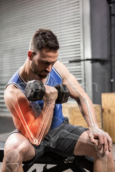 Determinated male athlete doing excercise with dumbbells Stock photo © wavebreak_media