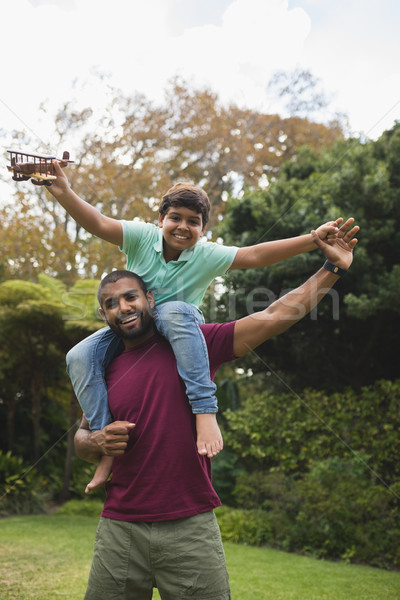 Cheerful father piggybacking son at park  Stock photo © wavebreak_media