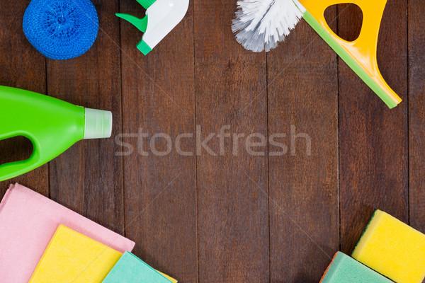 Cleaning equipments arranged on wooden floor Stock photo © wavebreak_media