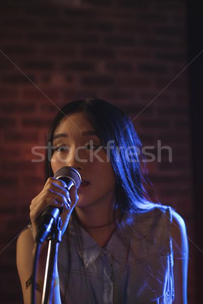 Beautiful female singer singing at music concert Stock photo © wavebreak_media