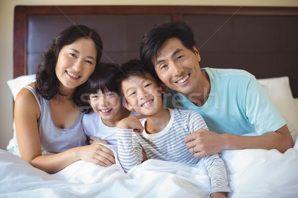 Family sitting together in bedroom Stock photo © wavebreak_media