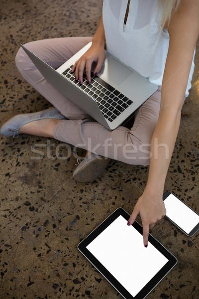 低い セクション 女性 ラップトップを使用して タブレット オフィス ストックフォト © wavebreak_media