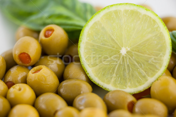 Close up of green olives with lemon Stock photo © wavebreak_media