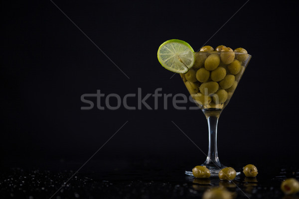 Cocktail martini with olives and lime on table Stock photo © wavebreak_media