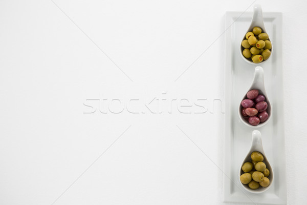 Various types of olives in spoon on serving tray Stock photo © wavebreak_media