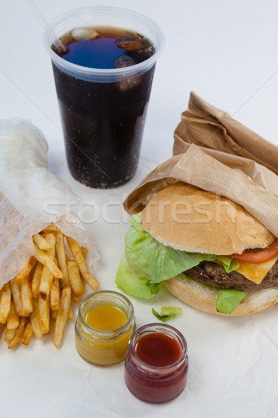 Close-up of hamburger, french fries, sauce and cold drink Stock photo © wavebreak_media