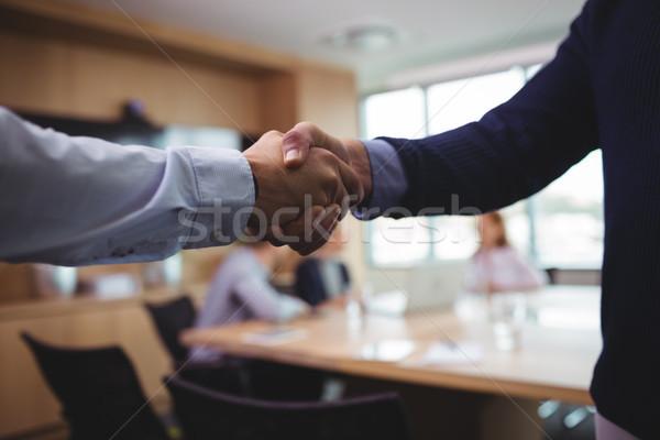 Zakenlieden handen schudden vergadering afbeelding computer Stockfoto © wavebreak_media
