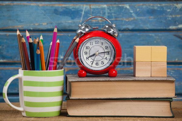 School supplies, alarm clock and wooden blocks on table Stock photo © wavebreak_media