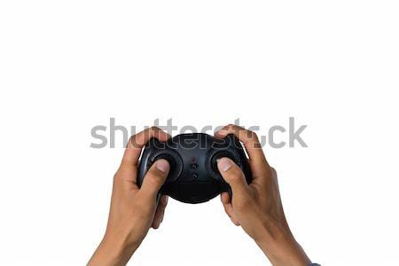 Cropped image of hand holding controller Stock photo © wavebreak_media