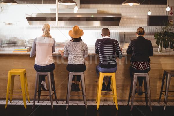 вид сзади сидят борьбе кофейня женщину Сток-фото © wavebreak_media