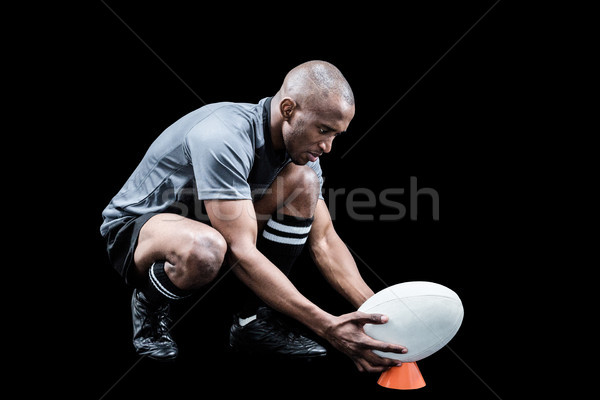 Rugby player keeping ball on kicking tee Stock photo © wavebreak_media