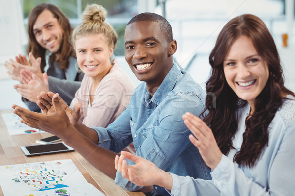 Portrait of smiling business people clapping at desk  Stock photo © wavebreak_media