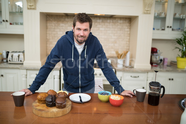 Man preparing muffins in the kitchen Stock photo © wavebreak_media