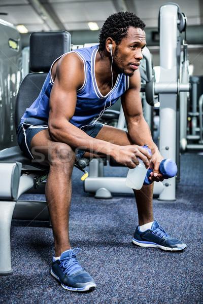 Zamyślony muskularny człowiek przerwie siłowni Zdjęcia stock © wavebreak_media