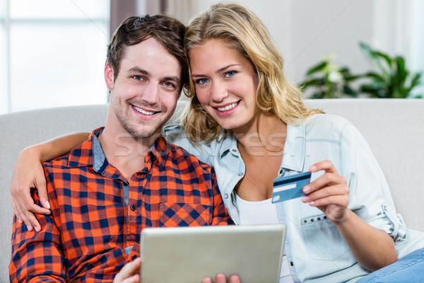 Pár fizet hitelkártya kanapé internet férfi Stock fotó © wavebreak_media
