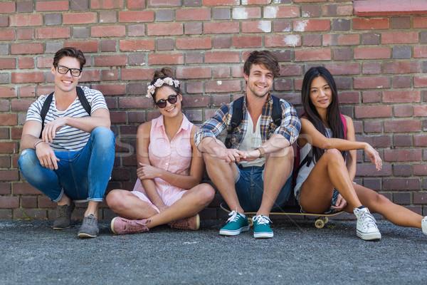 Csípő barátok ül padló Wall Street nő Stock fotó © wavebreak_media