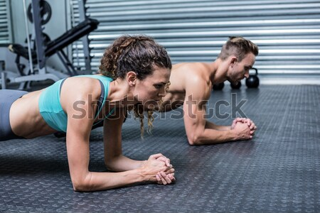 Muscular man doing push up with dumbbells Stock photo © wavebreak_media