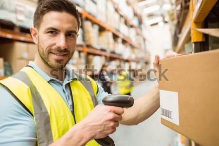 Warehouse worker scanning box Stock photo © wavebreak_media