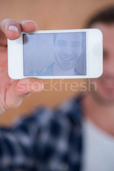 Handsome hipster taking selfie Stock photo © wavebreak_media