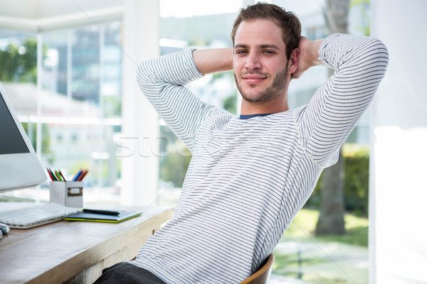 Handsome businessman relaxing on his desk chair Stock photo © wavebreak_media