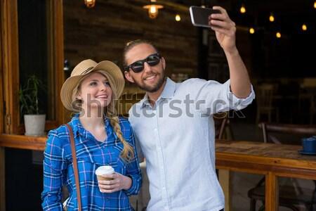 Pár italok áll erkély boldog üdülőhely Stock fotó © wavebreak_media
