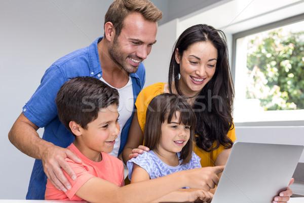 Happy family interacting using laptop Stock photo © wavebreak_media