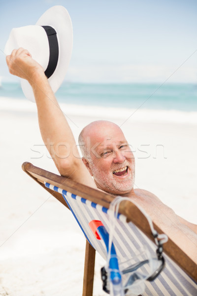 Senior man holding his sunhat Stock photo © wavebreak_media