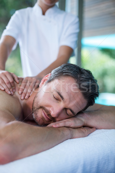 Man receiving back massage from masseur Stock photo © wavebreak_media