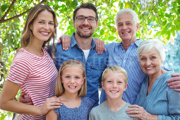 Smiling family standing against tree Stock photo © wavebreak_media