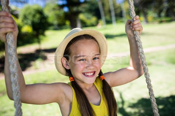 幸せな女の子 座って スイング 公園 肖像 ストックフォト © wavebreak_media