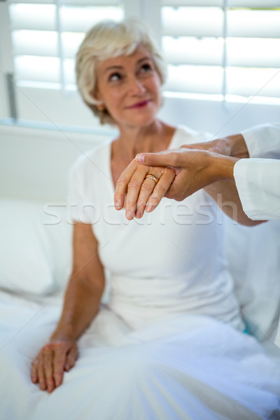 Cropped image of doctor assisting senior woman Stock photo © wavebreak_media