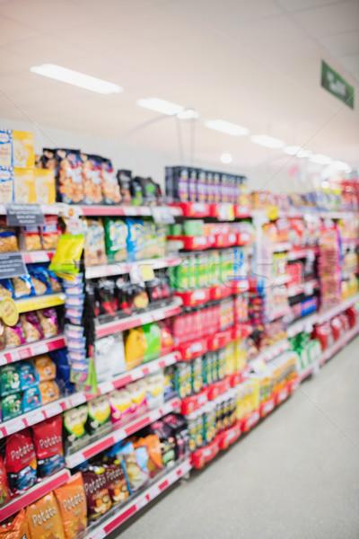 Vue de côté supermarché tablettes épicerie lumière Shopping Photo stock © wavebreak_media