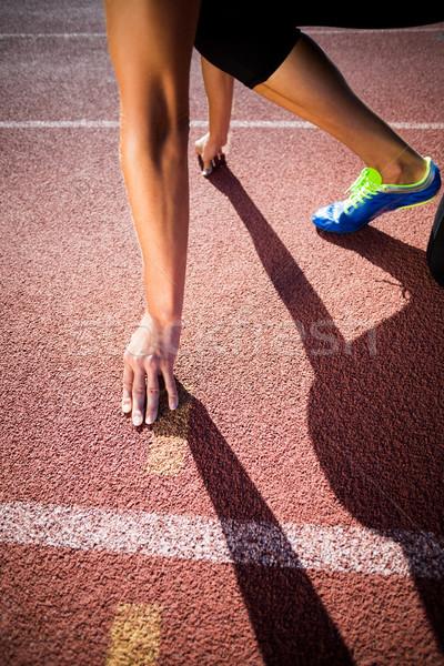 Kadın atlet hazır çalıştırmak pozisyon çalışma Stok fotoğraf © wavebreak_media