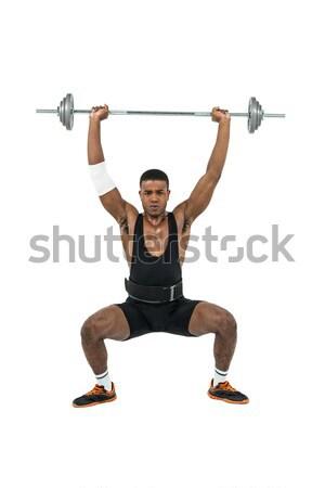 Bodybuilder lourd barbell poids blanche Photo stock © wavebreak_media