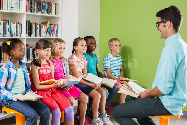 Teacher teaching kids in library Stock photo © wavebreak_media