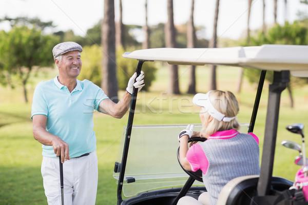 зрелый человек глядя женщину сидят гольф улыбаясь Сток-фото © wavebreak_media