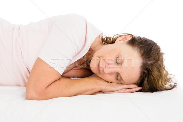 Woman sleeping on white sheet Stock photo © wavebreak_media