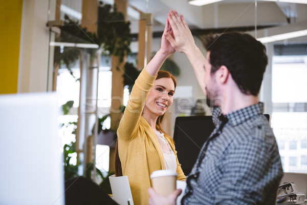 Businesswoman giving high-five to male coworker Stock photo © wavebreak_media