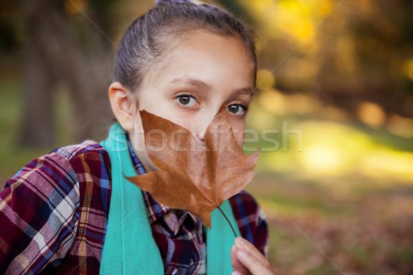 Ritratto ragazza nascondere bocca autunno foglia Foto d'archivio © wavebreak_media